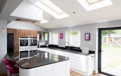 Kitchen extension mix of white windows and dark doors